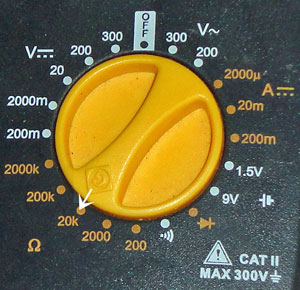 Move the dial on your meter to 20K Ohms Ω